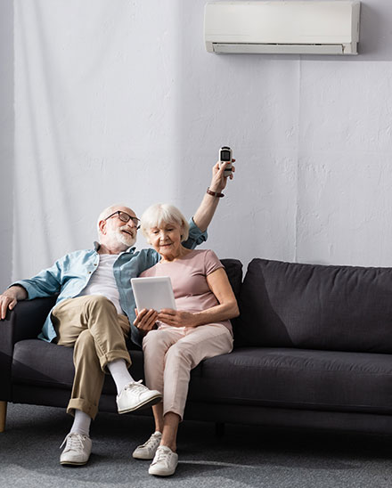 old couple with air conditioning
